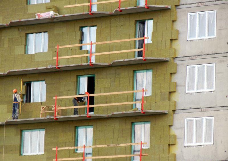 Утепление фасада многоквартирного дома: способы и этапы работ