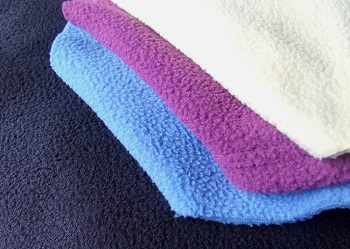 Флисовая ткань: характеристика, достоинства и применение